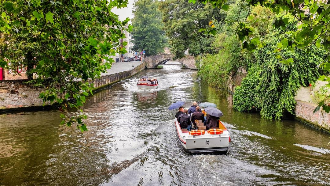 Canal boats umbrellas Bruges Belgium