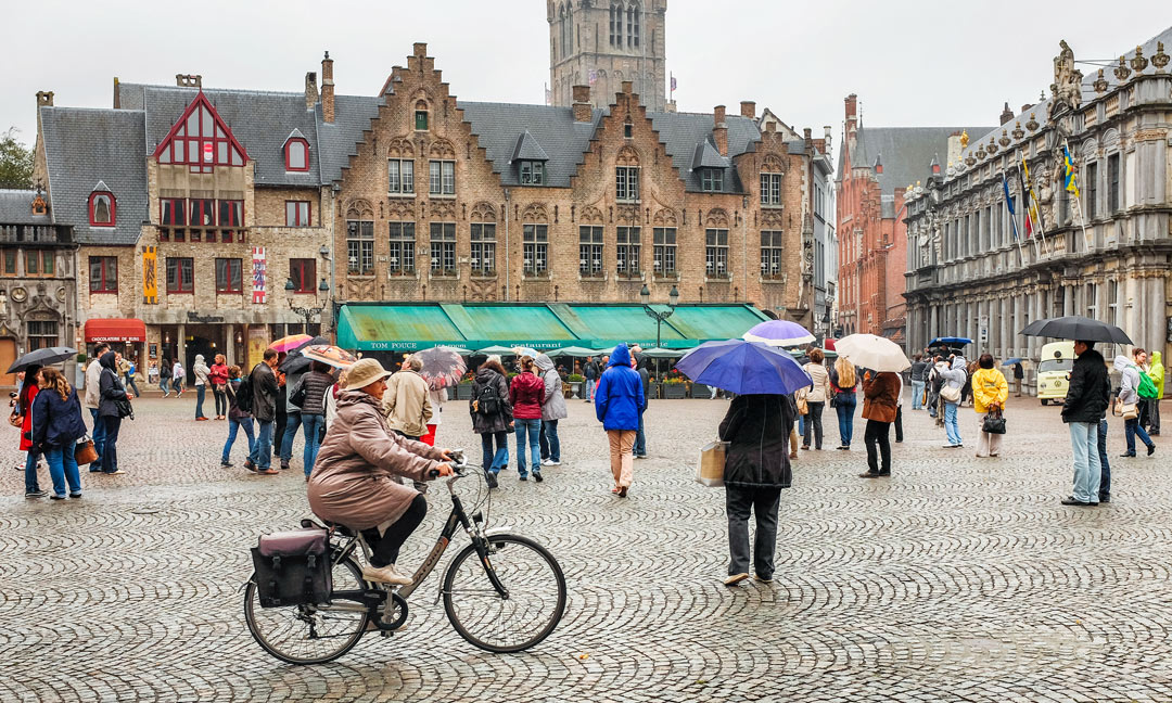 Markt woman bicycle Bruges Belgium