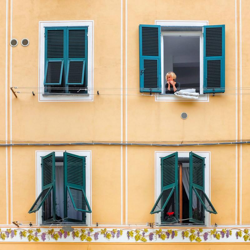 Vernazza woman in window Cinque Terre Italy