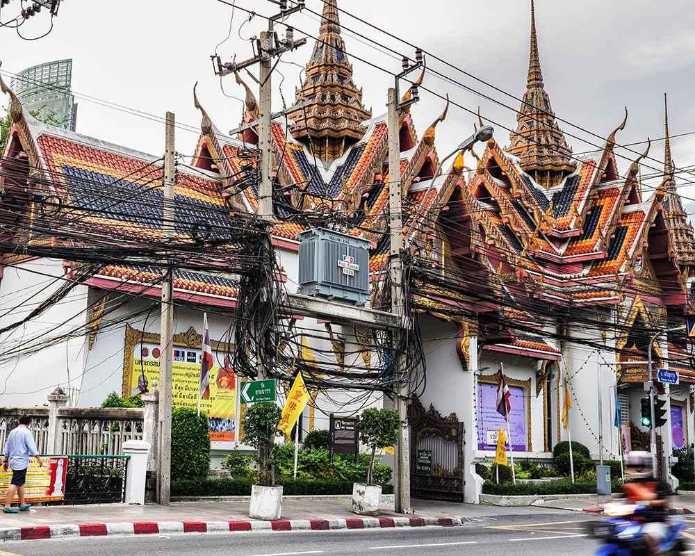 Bangkok temple utility wires Bangkok Thailand