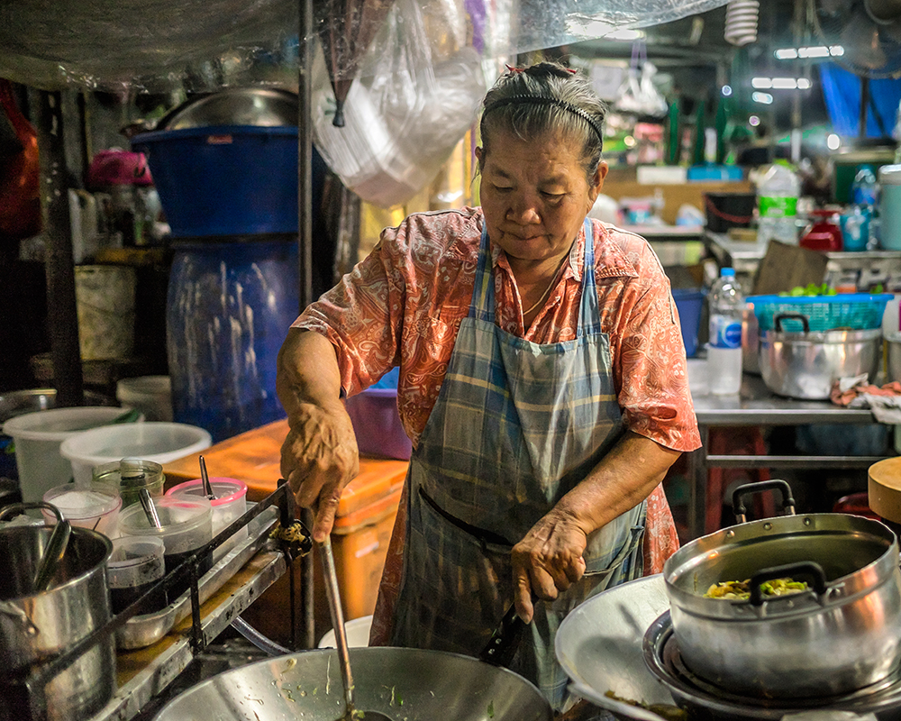 Night market woman Bangkok Thailand