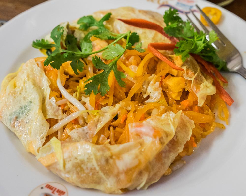Thipsamai opened egg wrapped Pad Thai Bangkok Thailand