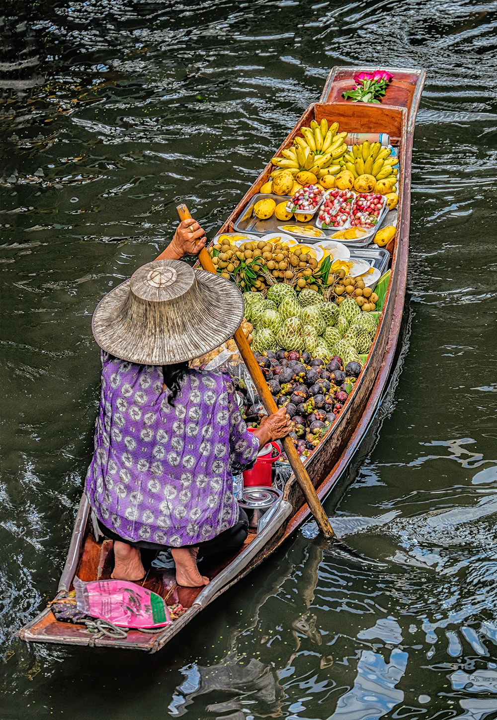 Damnoen Saduak Floating Market woman rowing fruit Bangkok Thailand