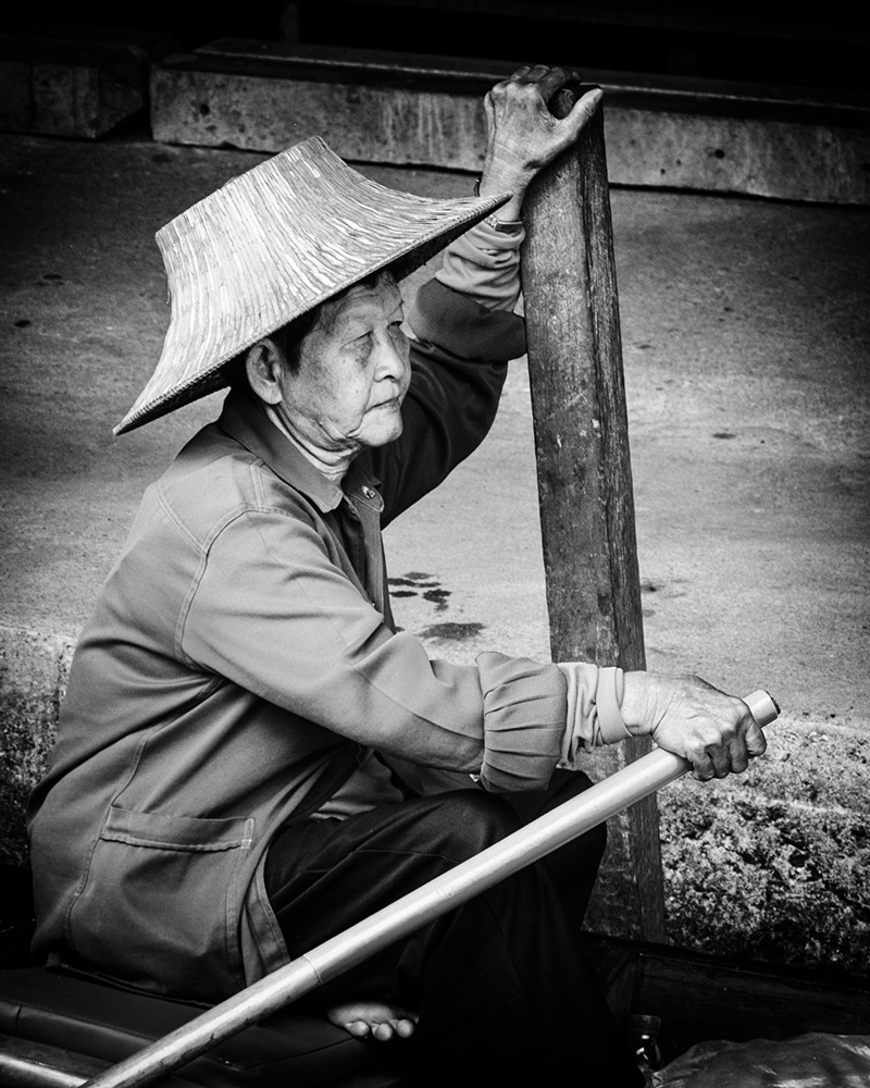 Damnoen Saduak floating market elderly woman hat Bangkok Thailand