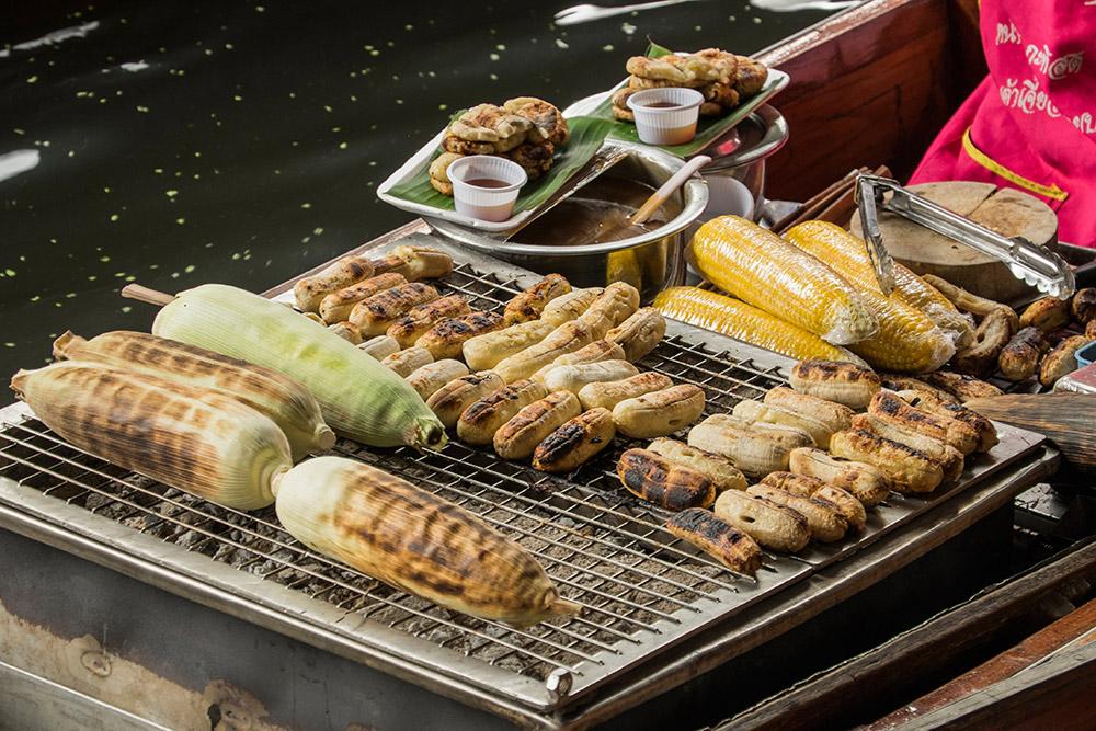 Damnoen Saduak floating market grilled corn Bangkok Thailand
