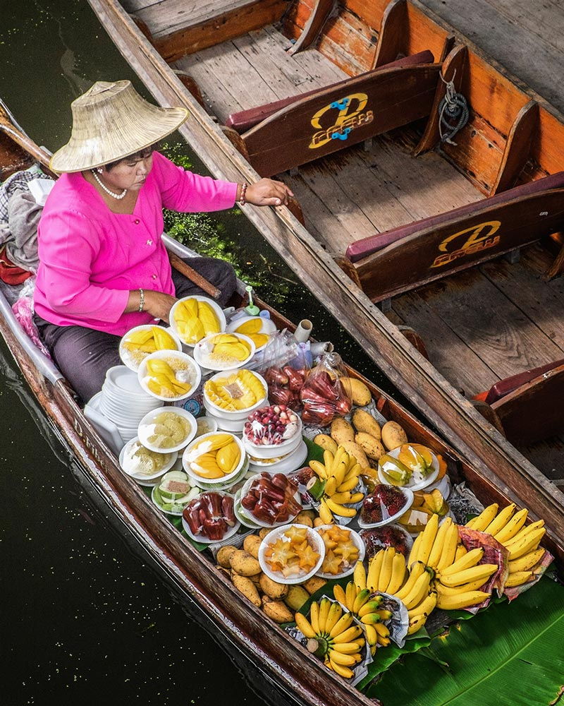 Damnoen Saduak floating market woman pearls Bangkok Thailand