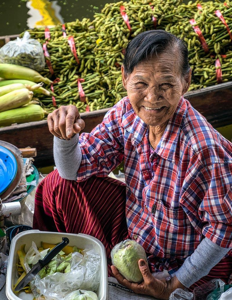 Damnoen Saduak floating market woman smiling Bangkok Thailand
